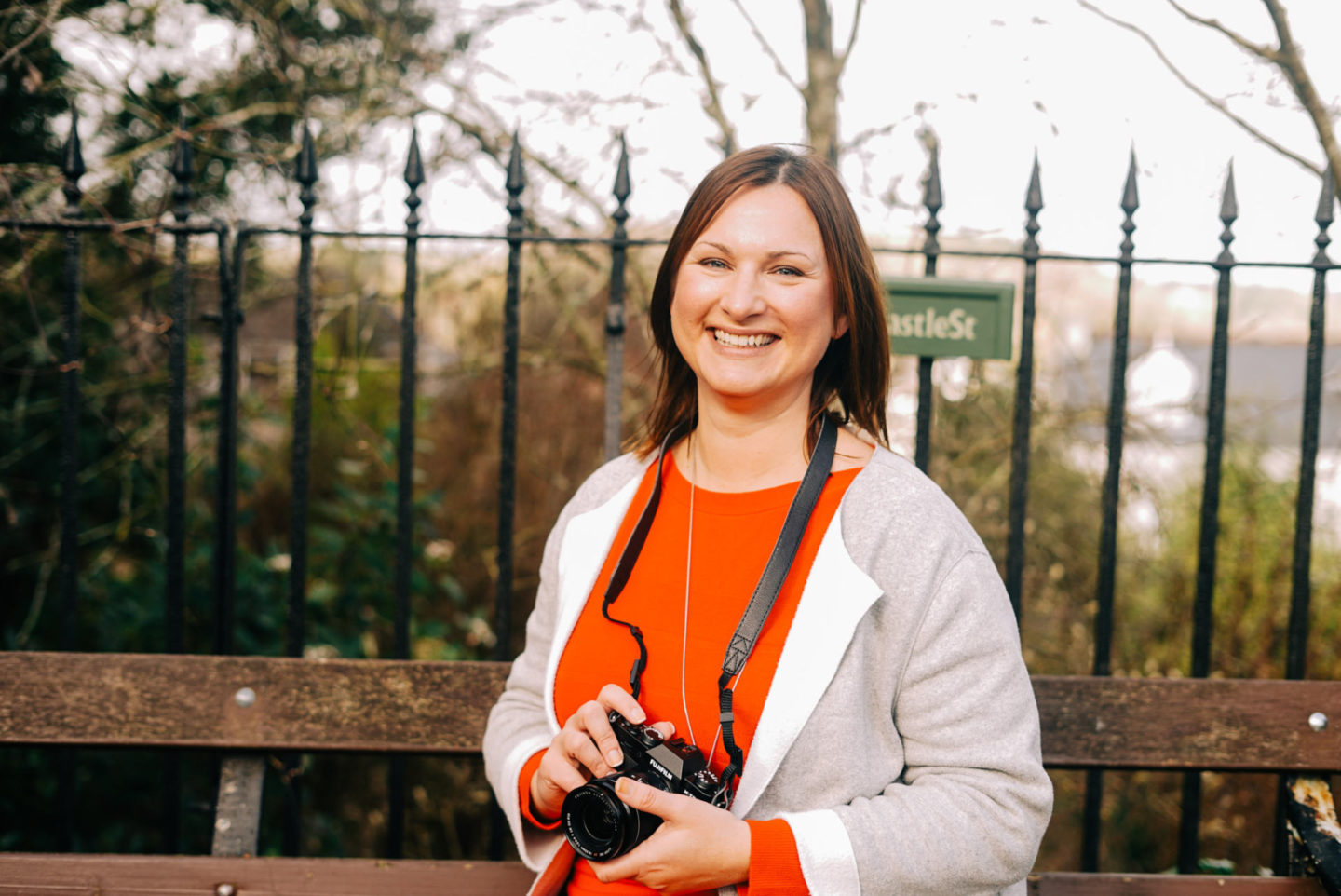 Claire Hall, founder of Travel Influence and award winning travel blogger, holding camera
